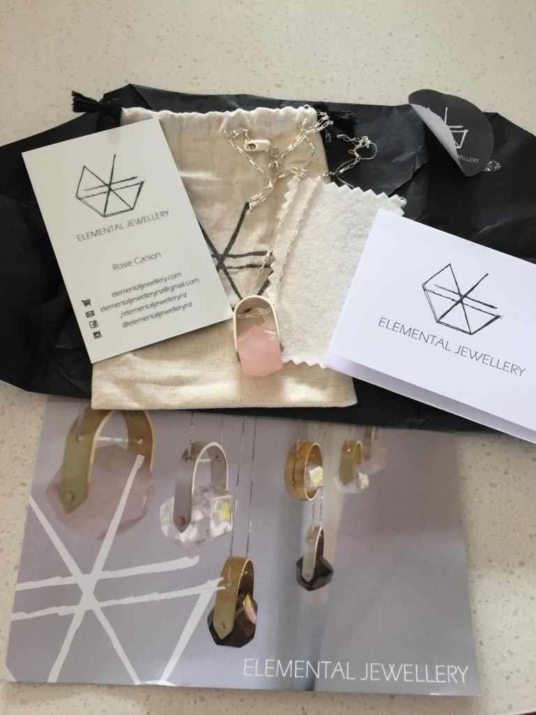 when I first opened my jewelry package-necklace, cards, cleaning cloth, instructions and packaging from Elemental Jewellery