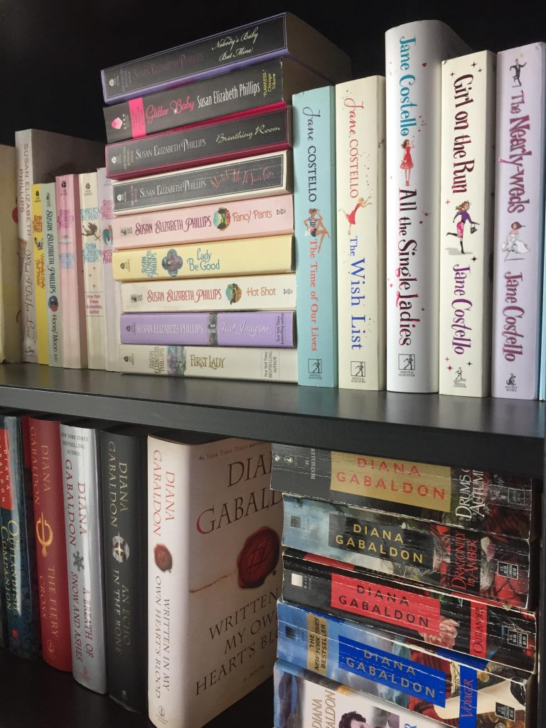 the book collections of my three favourite authors, on the book shelves