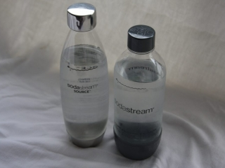Two styles of SodaStream Water Bottles filled with water