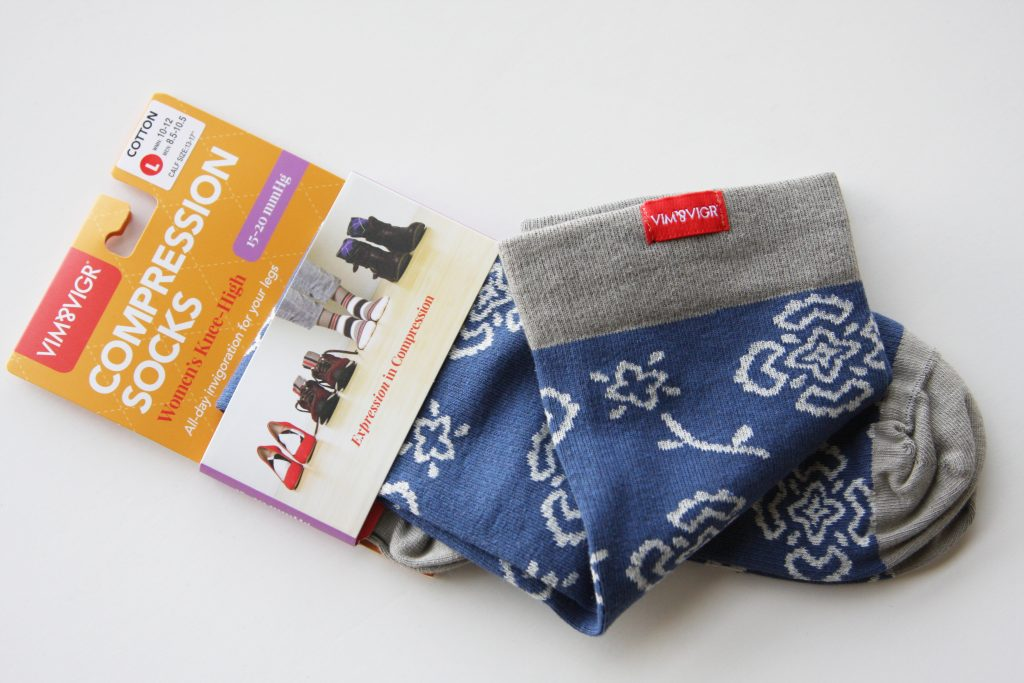 VIM & VIGR Compression Socks in package with folded socks