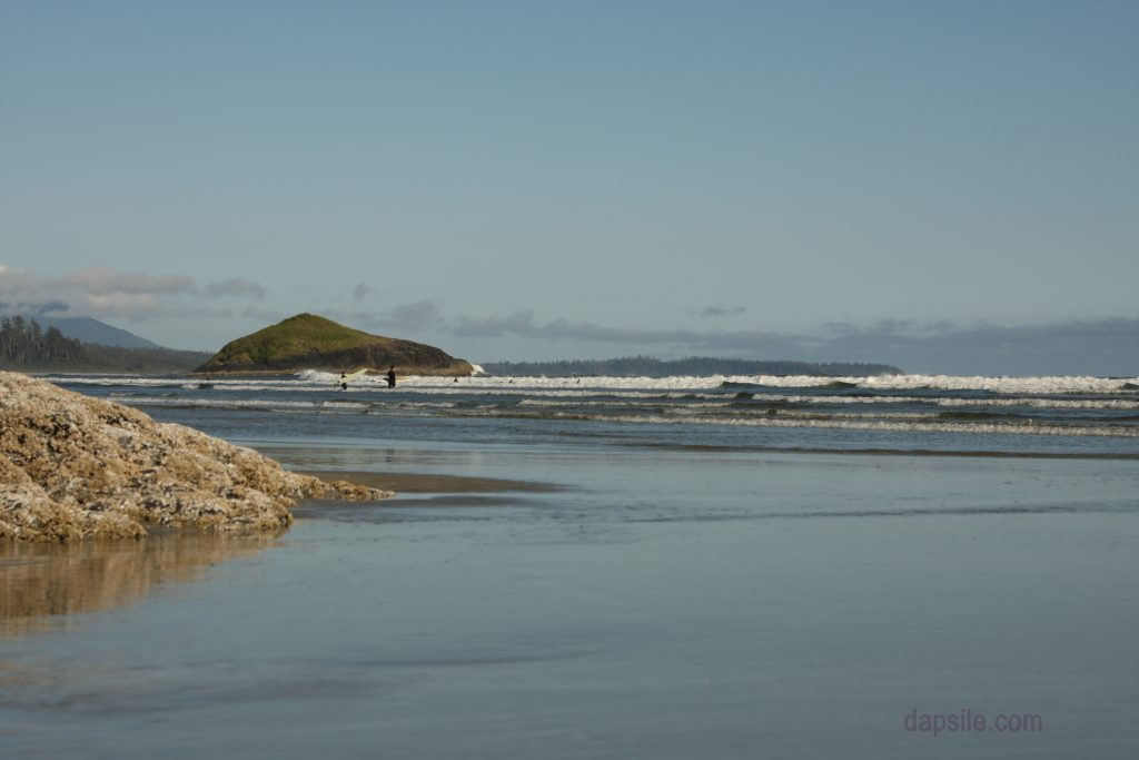 some surfers in the ocean at Long Beach near Tofino