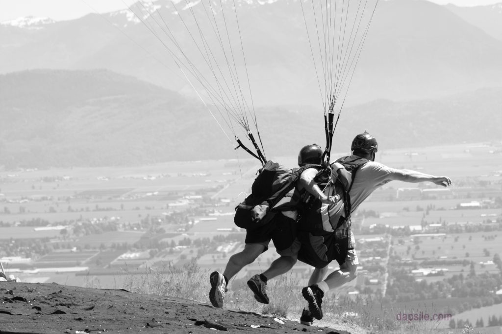 Two people tandem takeoff for Paragliding