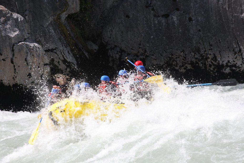 waves taking over the raft while White Water Rafting