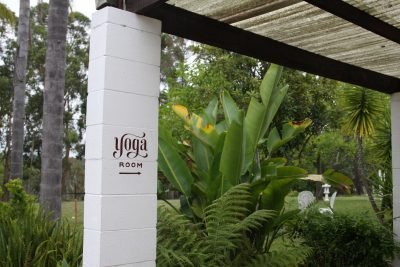 Sign Pointing To the Yoga Room at Swami's Yoga Retreat