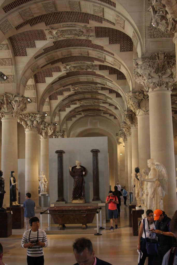 A Hall Containing Marble Statues in the Louvre in Paris