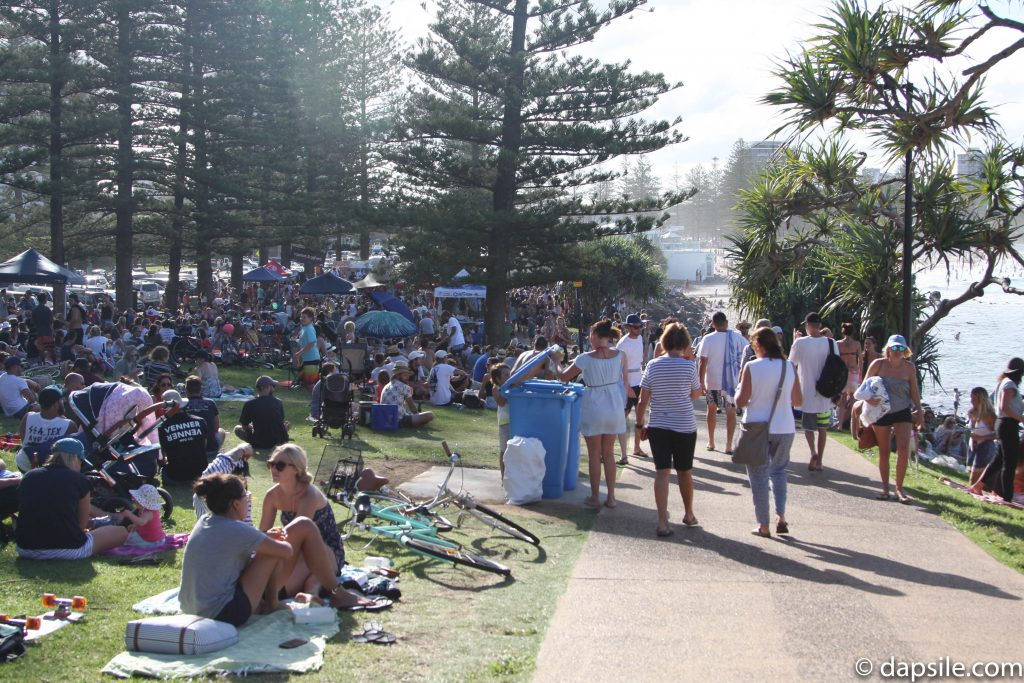 Crowd of People in a Park Along the Gold Coast