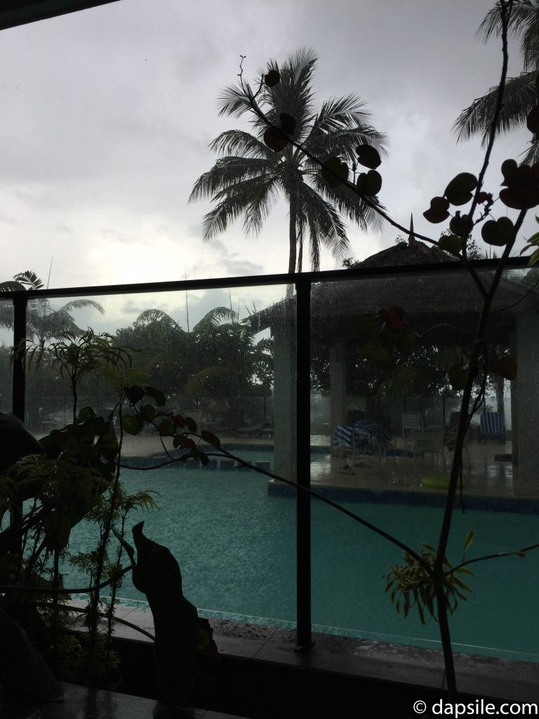 Watching the rain at the Pool at Fitzroy Island Resort