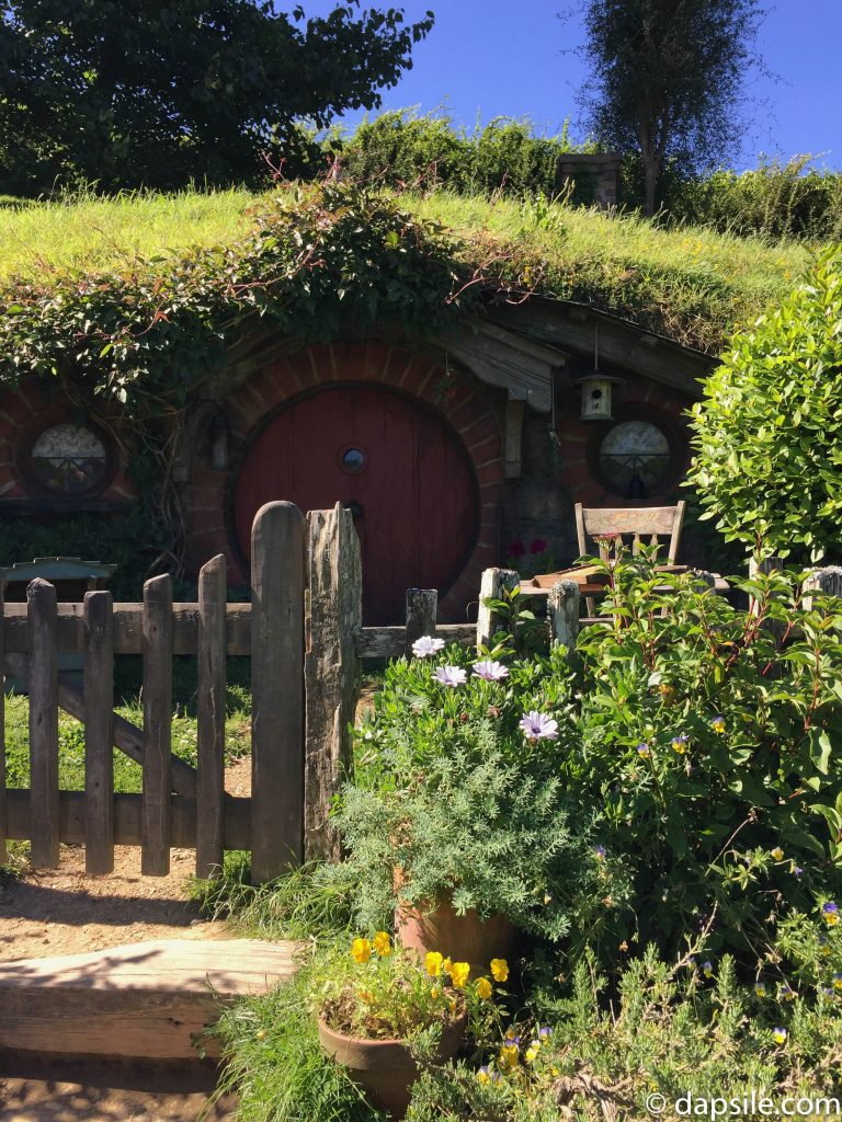 Hobbit Home with Red Door at Hobbiton on the drive from Wellington to Auckland