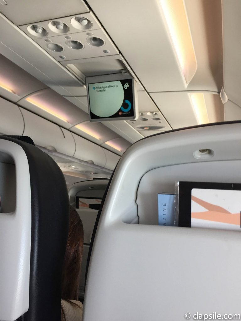 Screen hanging from the ceiling Inside Air New Zealand Airplane