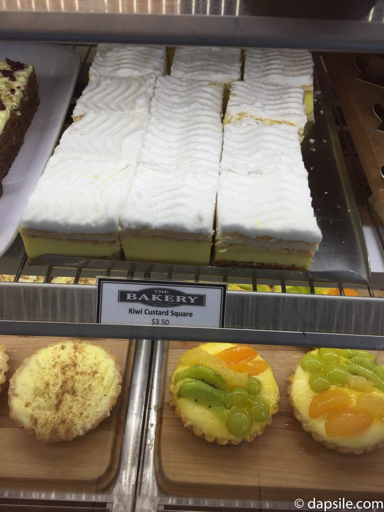Kiwi Custard Square and other treats on the shelf in The Bakery The Doughbin