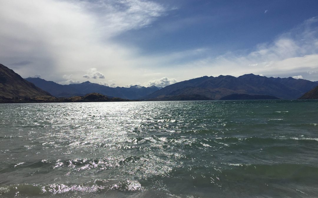 Looking out across Lake Wanaka with mountains in the distance in Wanaka New Zealand