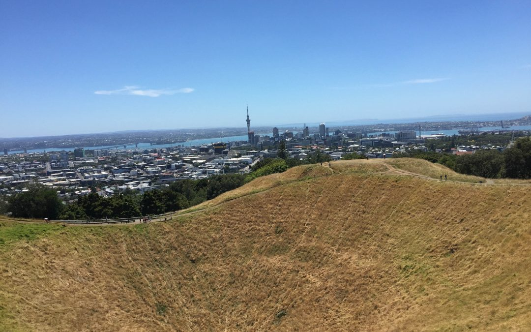 city of Auckland New Zealand behind a volcano crater