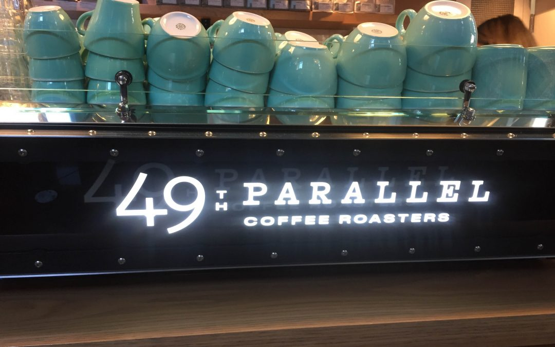 49th Parallel Coffee Roasters Sign with Mugs